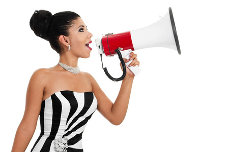 Stock image of bossy woman in formalwear using bullhorn over white background