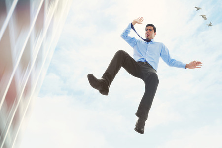fiscal cliff: Stock image of businessman falling off a building