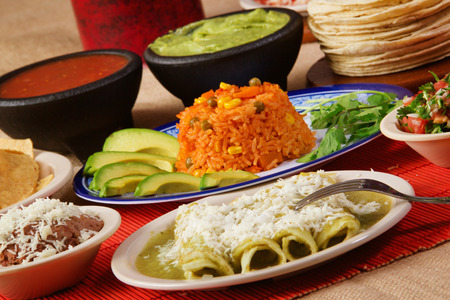 Stock image of traditional mexican food green enchilada dinner Stock Photo