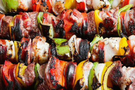 Stock image of close up of grilled beef and chicken kebabs