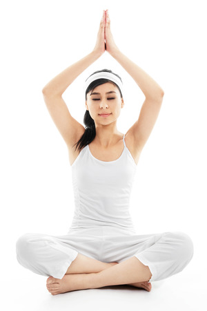 Stock image of woman meditating over white background