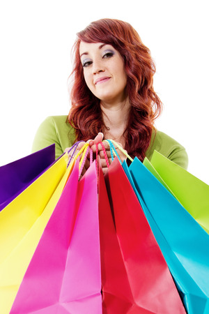 Stock image of female shopper isolated on white background