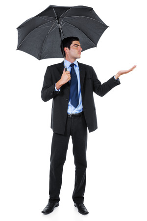 Stock image of businessman with umbrella isolated on white background Zdjęcie Seryjne