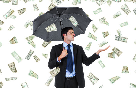 Stock image of businessman with umbrella and falling money