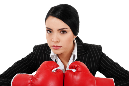 Stock image of businesswoman with boxing gloves isolated on white background