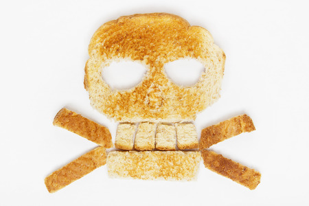stock: Stock image of bread skull and crossbones on white background