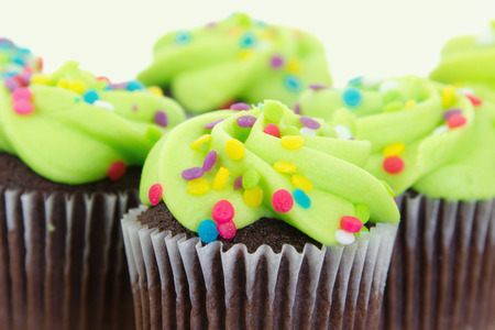 Stock image of arrangement of freshly baked and decorated green cupcakes