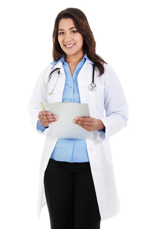 Stock image of female doctor smiling and holding chart, wearing lab coat, isolated on white Zdjęcie Seryjne
