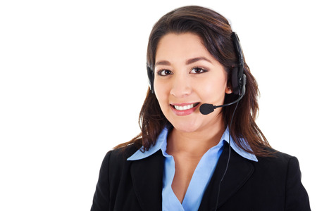 call: Stock image of female call center operator smiling, wearing business attire, isolated on white