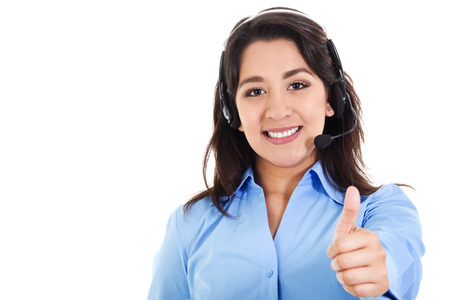 teleconferencing: Stock image of female call center operator smiling and giving thumbs up, wearing business attire, isolated on white Stock Photo