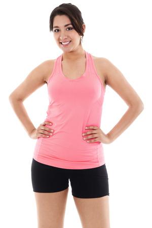 Stock image of smiling woman wearing exercise clothing isolated on white background