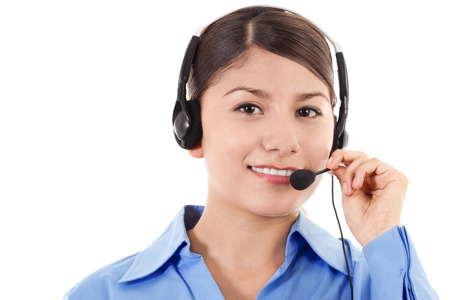 teleconferencing: Stock image of female call center operator smiling, wearing business attire, isolated on white