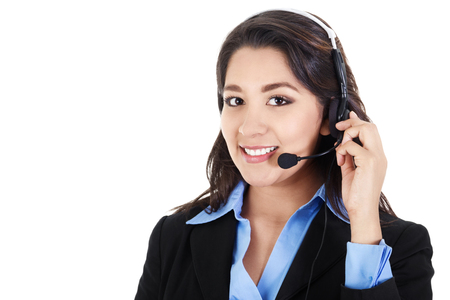 customer service representative: Stock image of female call center operator smiling, wearing business attire, isolated on white