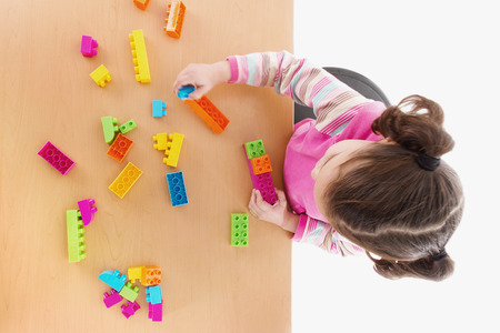 Stock image of little girl playing with construction blocks, top view Zdjęcie Seryjne - 47858034