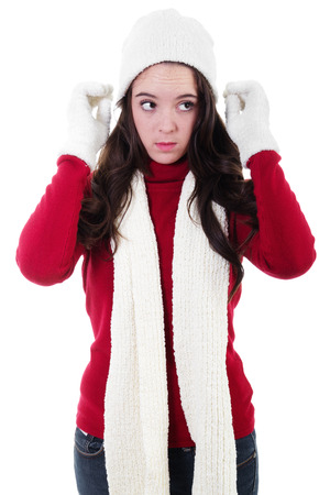 Stock image of teen dressing warm for winter, isolated on white