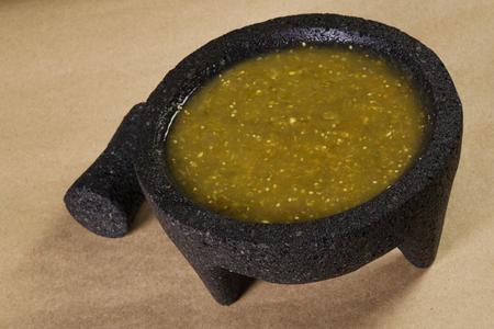 Stock image of mexican salsa verde on mortar and pestle Zdjęcie Seryjne - 73415245