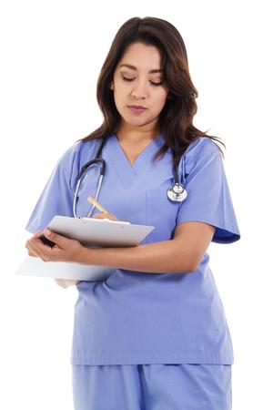 Stock image of female nurse writing on patient chart isolated on white background Zdjęcie Seryjne