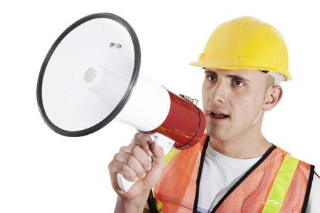 Construction foreman giving orders on bullhorn isolated on white background Zdjęcie Seryjne - 104785283