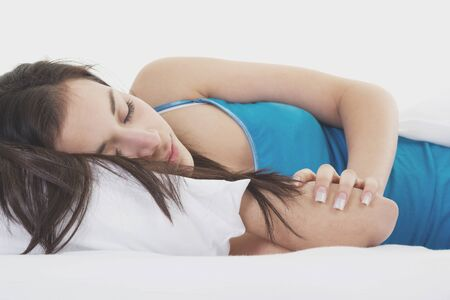 Stock image of woman sleeping on white bed Zdjęcie Seryjne
