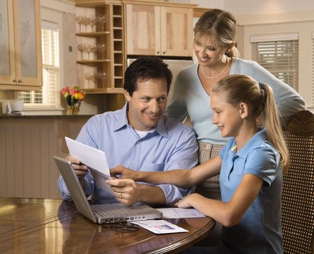 Caucasian family paying bills on laptop computer. Stock Photo - 1762068
