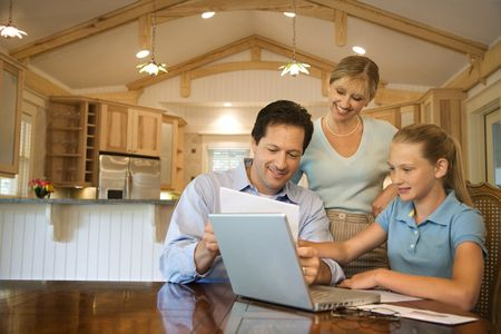 Caucasian family paying bills on laptop computer. Stock Photo - 1779232