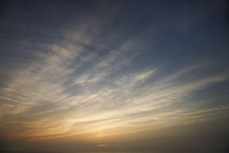 wispy: Wispy clouds at sunset. Stock Photo