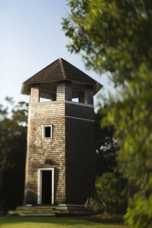 bald head island: Brick tower standing in park.