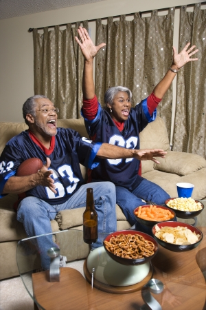 football jersey: Couple watching sports. Stock Photo
