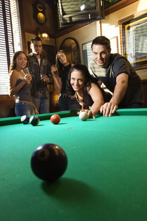 pool ball: Young caucasian woman receiving advice on shooting pool ball while playing billiards. Stock Photo