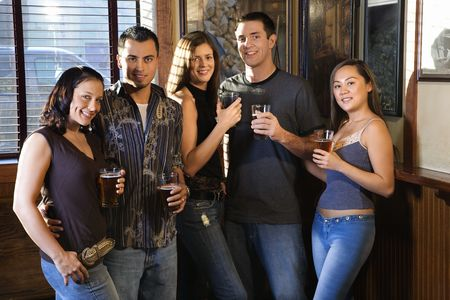 Group of young friends hanging out in pub and drinking beer. Stock Photo - 1798662