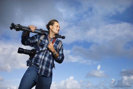 Man holding photography equipment. Stock Photo