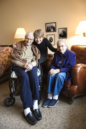 Caucasian middle-aged daughter with elderly parents in retirement community center. photo