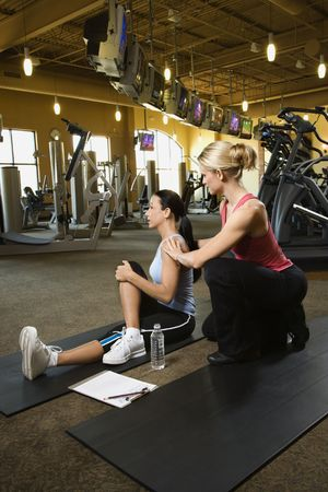 Woman with personal trainer. photo