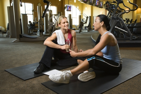 buddy: Prime adult Caucasian female with personal trainer at gym.