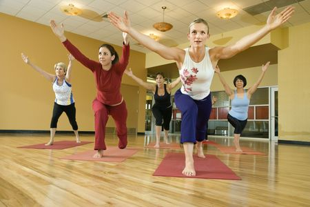Prime adult female Caucasians in yoga class. Stock Photo - 1799020