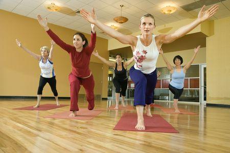 Prime adult female Caucasians in yoga class. Stock Photo - 1799020