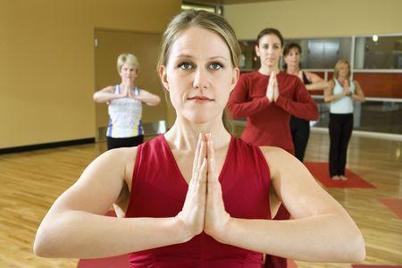 prime: Prime adult female Caucasians in yoga class.