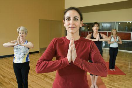 Prime adult female Caucasians in yoga class. photo