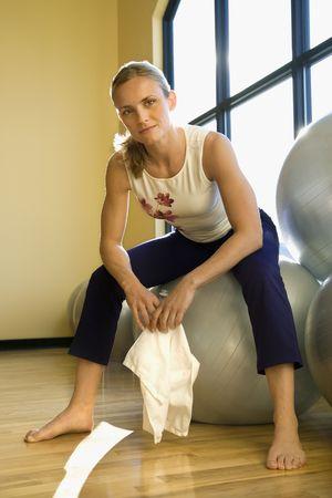 prime adult: Portrait of prime adult female Caucasian at gym. Stock Photo