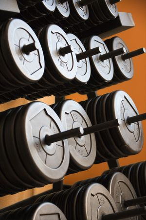 Stacked barbells with weights. photo