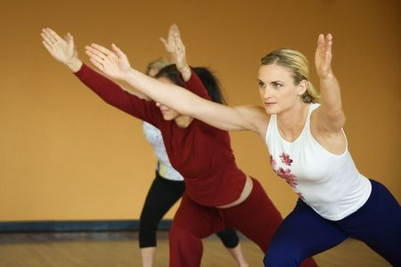prime adult: Caucasian prime adult females in yoga class.
