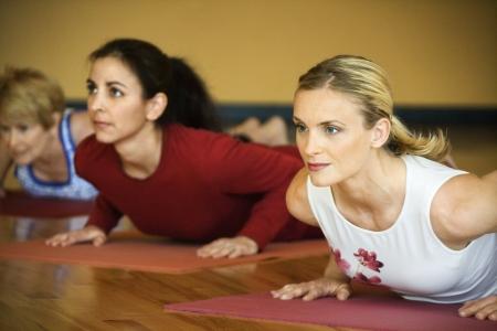 Caucasian prime adult females in yoga class. photo
