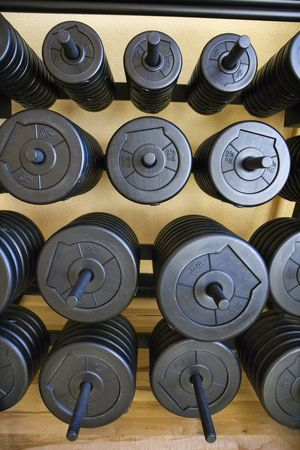 Stacks of barbell weights at gym. photo