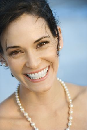 Portait of Caucasian mid-adult woman in pearls smiling and looking at viewer. Stock Photo - 1795799