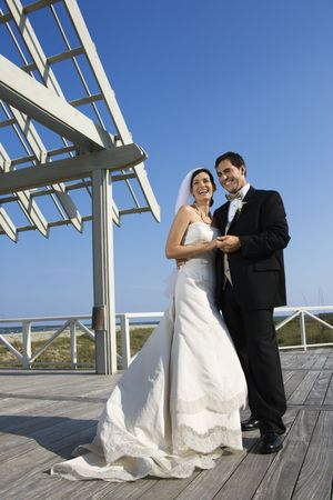 Caucasian mid-adult bride and groom wedding portrait outside at beach. Stock Photo - 1795789