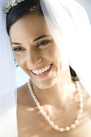 Portrait of Caucasian mid-adult bride smiling. photo