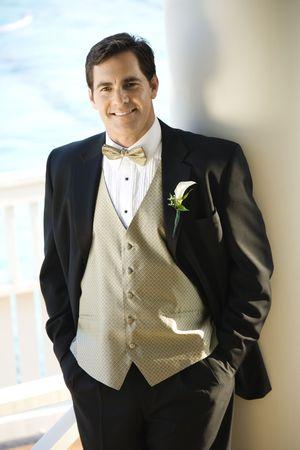 Portrait of Caucasian mid-adult groom in tuxedo smiling. Stock Photo - 1795809