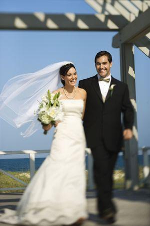 Bride and groom walking. photo