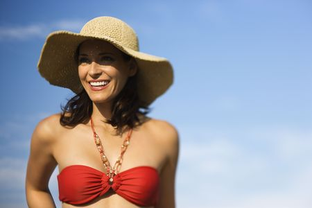 Caucasian mid-adult female in swimsuit and straw hat. Stock Photo - 1795785