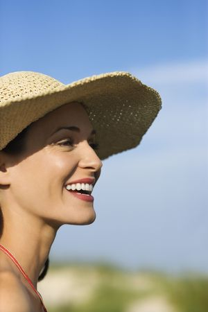 straw hat: Caucasian mid-adult female in swimsuit and straw hat. Stock Photo
